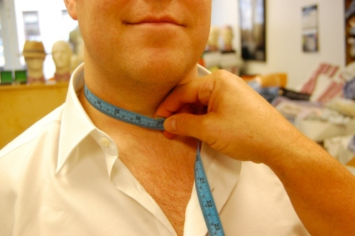 When measuring neck circumference, position the tape 1'' below Adam's apple