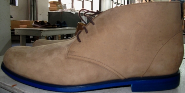 Tan suede desert boots with blue rubber soles