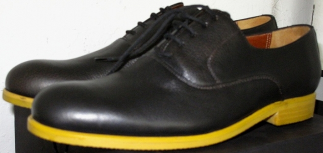 Black leather balmorals with yellow wood soles