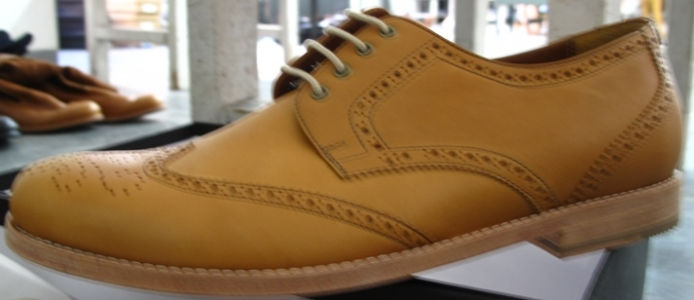 Light brown leather wingtips with wood soles